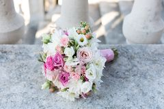 Bridal bouquet. On a stone Royalty Free Stock Photos