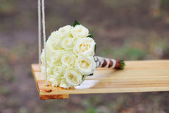 Bridal bouquet on swing Royalty Free Stock Photography