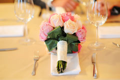Bridal bouquet on the table Royalty Free Stock Photo