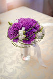 Bridal bouquet on the table of violet flowers Royalty Free Stock Photo