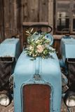 Bridal bouquet on a tractor Stock Photo