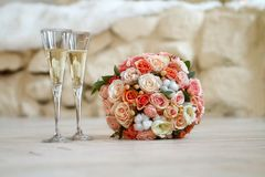 Bridal bouquet and two glasses of champagne Stock Image