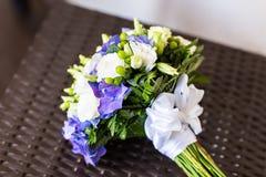 Bridal bouquet of various flowers Stock Photos