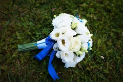 Bridal bouquet of various flowers on ground Royalty Free Stock Images
