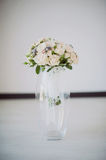 Bridal bouquet in a vase of glass Royalty Free Stock Photos