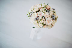 Bridal bouquet in a vase of glass Stock Photos