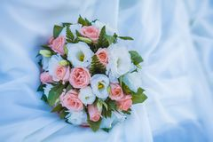 Bridal bouquet on the weddind dress Royalty Free Stock Images