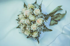Bridal bouquet on the weddind dress Royalty Free Stock Photos