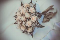 Bridal bouquet on the weddind dress Stock Photo
