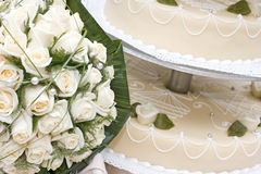 Bridal bouquet and wedding cake Royalty Free Stock Photo