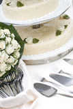 Bridal bouquet and wedding cake Stock Photos