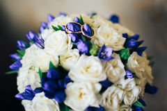 Bridal bouquet with wedding rings Royalty Free Stock Photo
