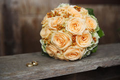 Bridal bouquet with wedding rings Stock Image