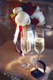 Bridal bouquet and wedding rings in the box with two glasses of champagne Stock Images