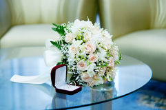 Bridal bouquet and wedding rings Stock Image