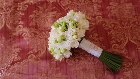 Bridal bouquet and wedding rings. On red background stock footage