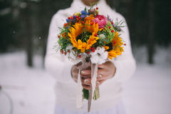 Bridal bouquet, wedding in winter. Bridal wedding flowers and bride closeup., wedding in winter royalty free stock photo