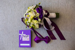 Bridal bouquet of white and blue flowers, rings, purple butterfly and invitation-cards Royalty Free Stock Photography