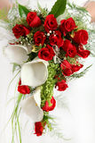 Bridal bouquet. With white cala and red roses white background Royalty Free Stock Images