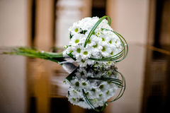 Bridal bouquet of white flowers. Lay on the lid of the piano black Stock Image