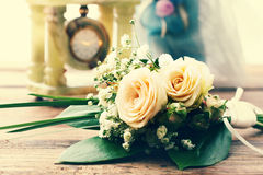 Bridal bouquet of white flowers on wooden surface. Summer wedding day, unusual designer florist bouquet of delicate roses. Free space for text Royalty Free Stock Image