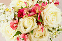 Bridal bouquet of white flowers on wooden surface. Stock Image