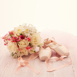 Bridal bouquet of white flowers on wooden surface. Royalty Free Stock Image