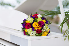 Bridal bouquet on a white piano Royalty Free Stock Image