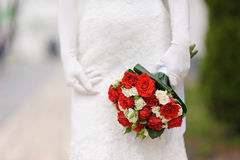 Bridal bouquet of white and red roses Stock Photos