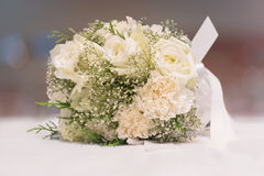 Bridal bouquet of white rose on blur background Royalty Free Stock Photos