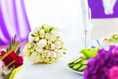 Bridal bouquet of white rose in bright colors.  Royalty Free Stock Photos