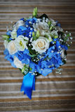 Bridal bouquet of white roses and blue ribbons Royalty Free Stock Images