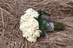 Bridal bouquet of white roses on a faded grass Stock Images