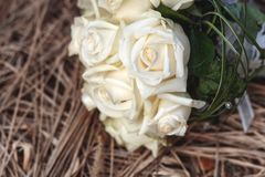 Bridal bouquet of white roses on a faded grass Stock Photography