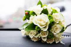 Bridal bouquet of white roses. Traffic jam on background Stock Image