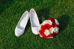 Bridal bouquet and white shoes bride Stock Image