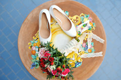 Bridal bouquet and white shoes in wedding day Royalty Free Stock Photos