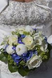 Bridal bouquet on white wedding dress Royalty Free Stock Photography
