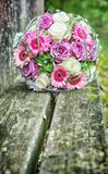 Bridal bouquet. On a wooden bench Stock Photo