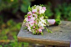 Bridal bouquet on a wooden bench Stock Photos
