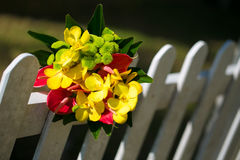 Bridal bouquet of yellow on the fence Royalty Free Stock Photos