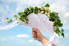 Bridal bunch of flowers. Photo of male hand holding a bridal bunch of flowers Stock Photos