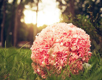 Bridal carnation bouquet in the grass Stock Photos