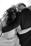 Bridal couple from behind, bw. Bridal couple lovely hugging each other. View from behind, Monochrome Stock Images