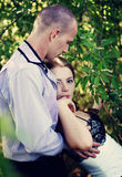 Bridal couple, bride and groom. Sensual embrace of the wedding couple on nature Royalty Free Stock Images