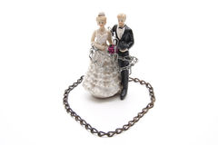 Bridal couple with chain Royalty Free Stock Photos