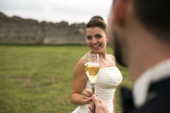 Bridal couple clink glasses of champagne Stock Photo