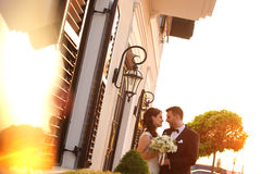 Bridal couple embracing in sunlight. Beautiful bridal couple embracing in sunlight Stock Images