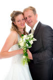 Bridal couple in front of white background Royalty Free Stock Image