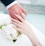 Bridal couple. Hands of bridal couple with wedding rings Royalty Free Stock Images